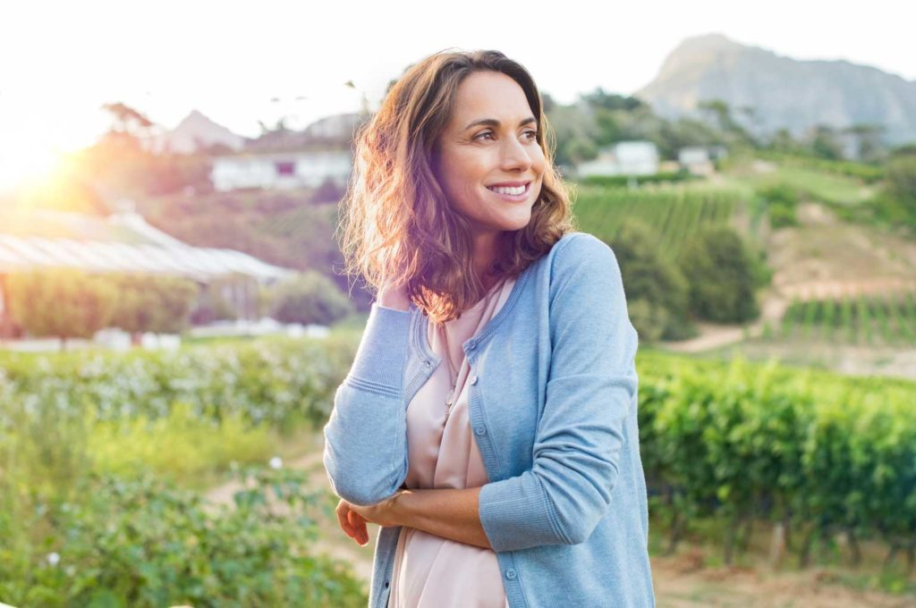 a woman outside smiling   How Can My Oral Hygiene Affect My Overall Health?