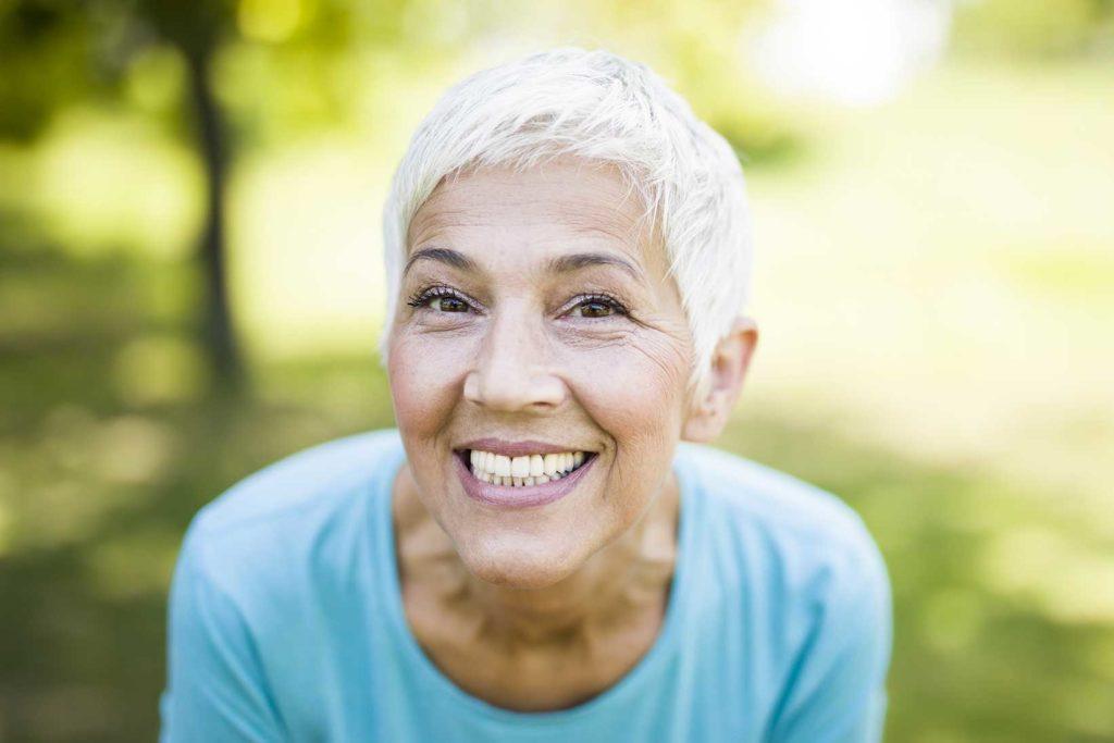 older woman smiling | Candidate for Dental Implants